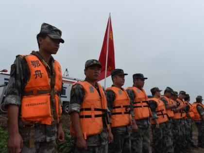 На данный момент спасатели КНР достают тела погибших из воды